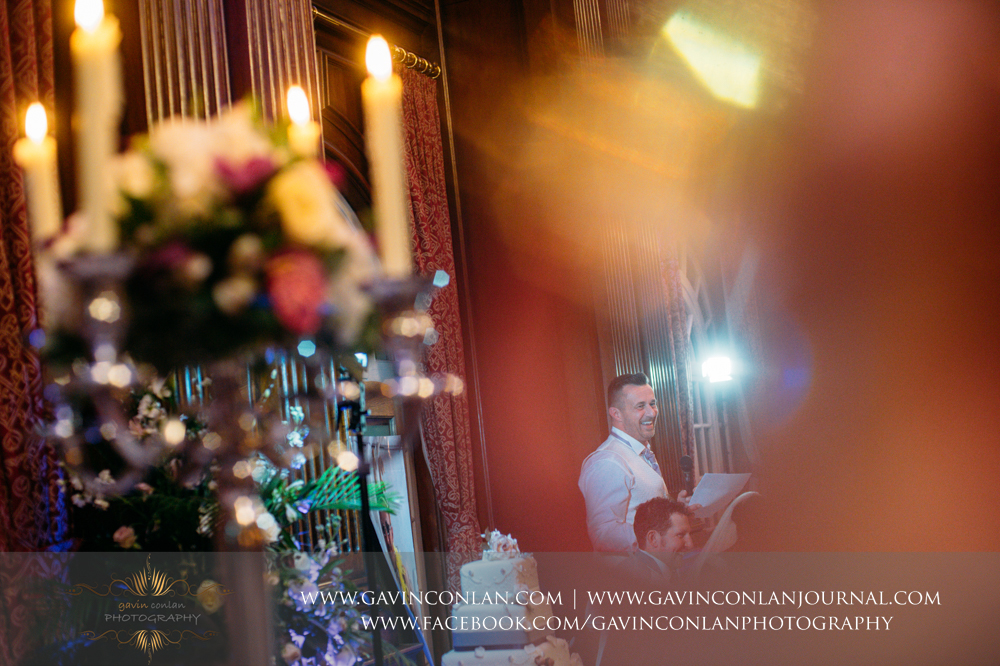 creative portrait of the groom during his speech, wedding photography at  Heatherden Hall Pinewood Studios  by  gavin conlan photography Ltd