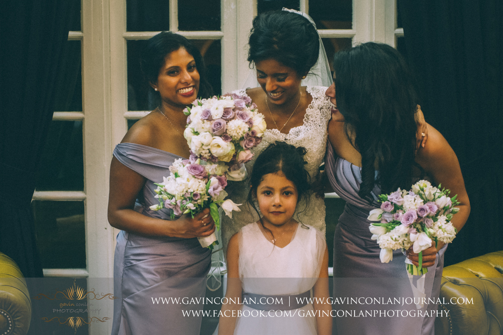 beautiful portrait of the bride, her bridesmaids and her flower girl, wedding photography at  Heatherden Hall Pinewood Studios  by  gavin conlan photography Ltd