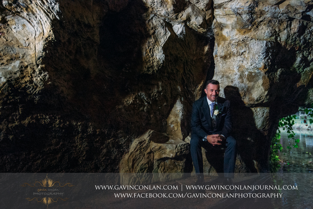 signature style groom portrait in the amazing cave, wedding photography at  Heatherden Hall Pinewood Studios  by  gavin conlan photography Ltd