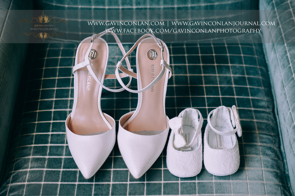 wedding detail shot of the brides shoes next to her baby daughters shoes.Wedding photography at  The SPA Hotel  by  gavin conlan photography Ltd
