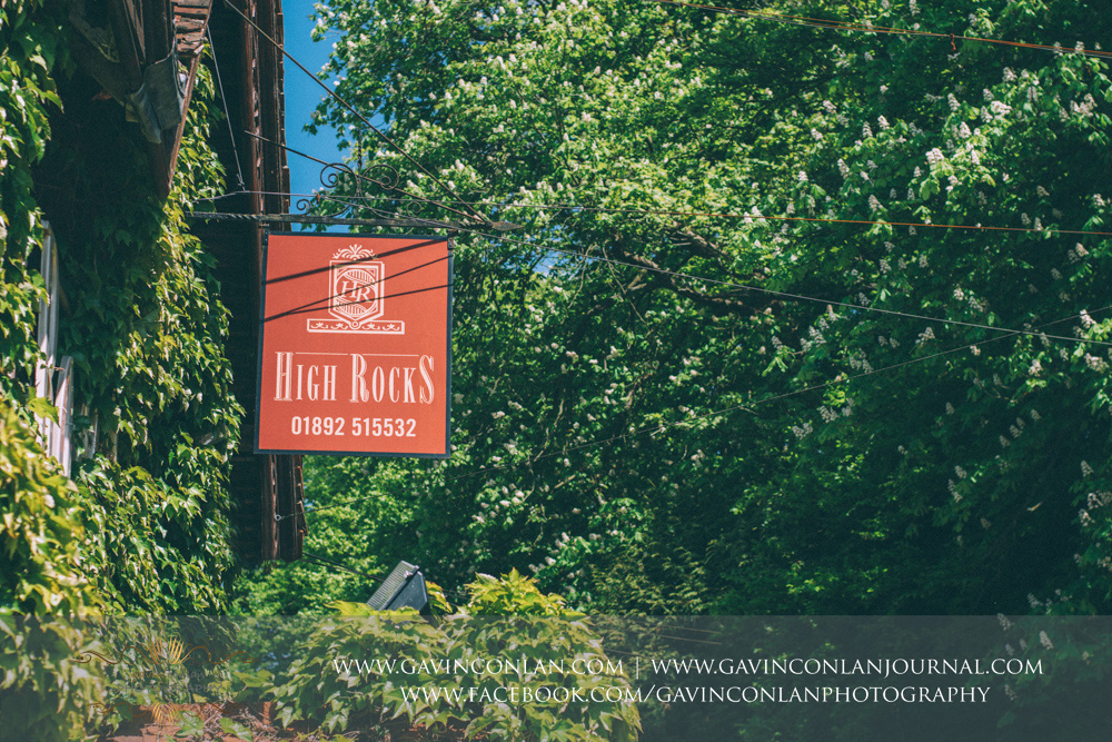 creative detail shot of the red High Rocks sign.Wedding photography at  High Rocks  by preferred supplier gavin conlan photography Ltd