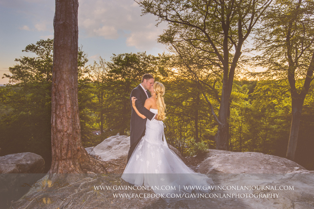 creative couple portrait of them sharing a kisstaken at the top of The Rocks at dusk.Wedding photography at  High Rocks  by preferred supplier gavin conlan photography Ltd
