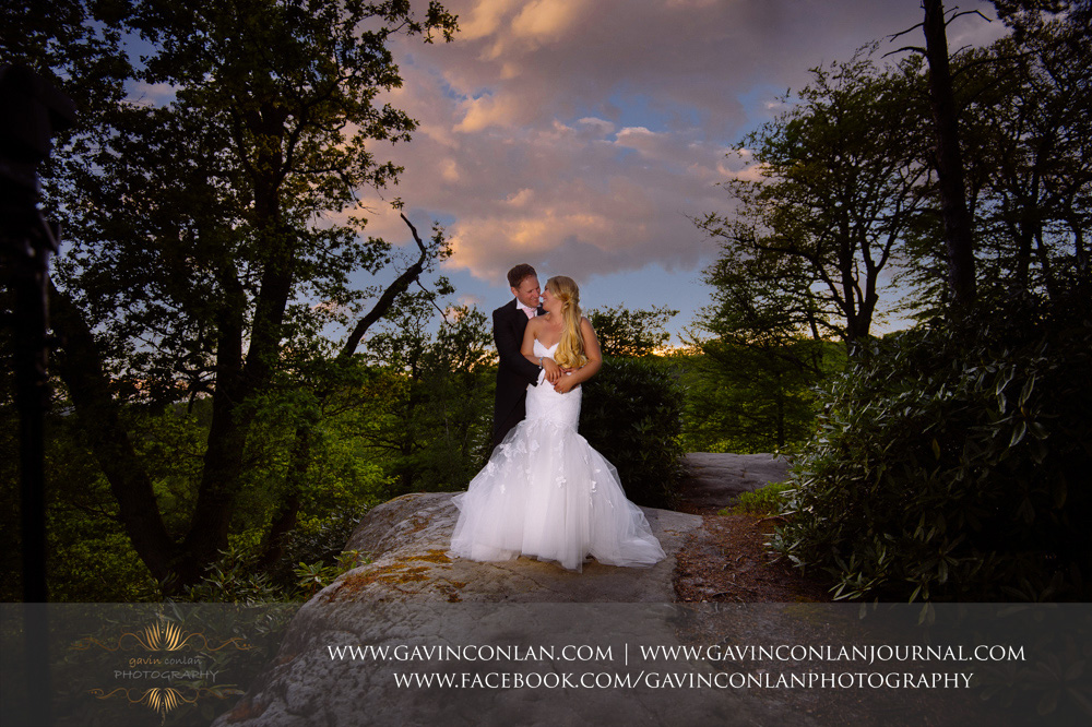 creative couple portrait taken at the top of The Rocks at dusk.Wedding photography at  High Rocks  by preferred supplier gavin conlan photography Ltd