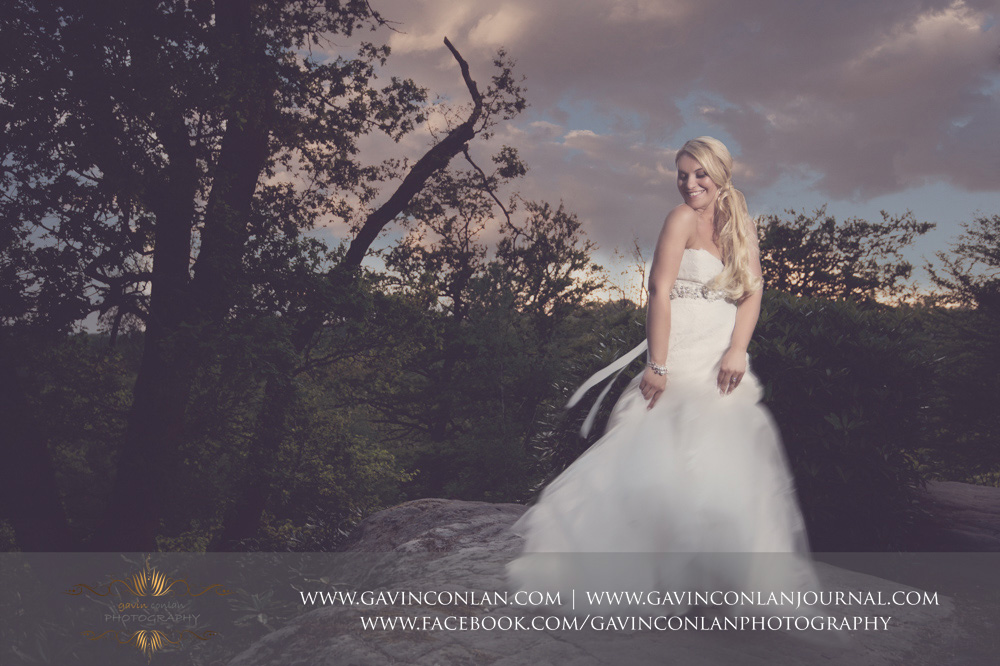creative and fun bridalportrait taken at the top of The Rocks at dusk.Wedding photography at  High Rocks  by preferred supplier gavin conlan photography Ltd
