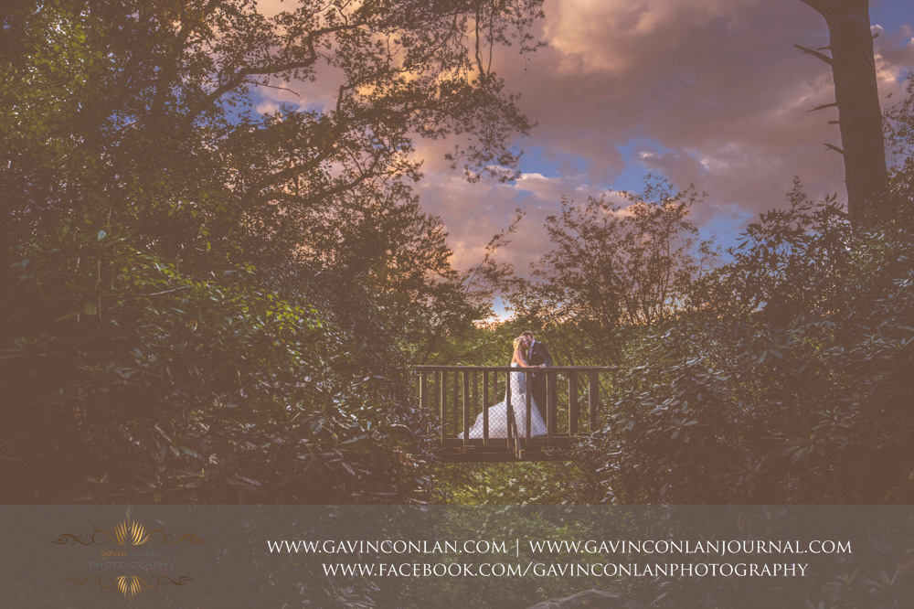 creative couple portrait taken at the top of The Rocks whilst posing on one of thebridges at dusk.Wedding photography at  High Rocks  by preferred supplier gavin conlan photography Ltd