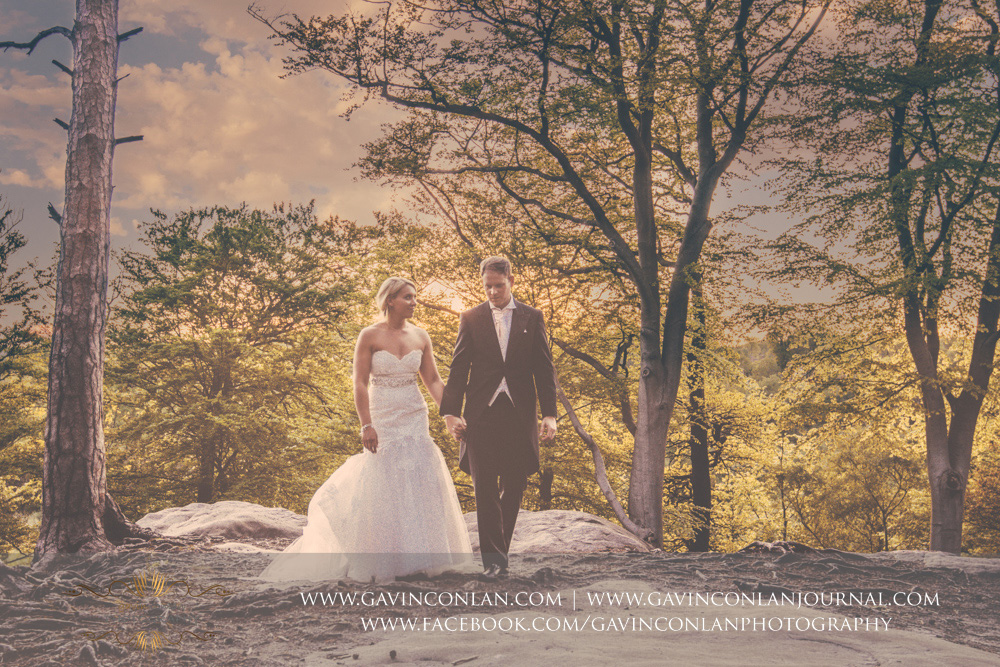 creative couple portrait of them walking together whilst taken at the top of The Rocks at dusk.Wedding photography at  High Rocks  by preferred supplier gavin conlan photography Ltd