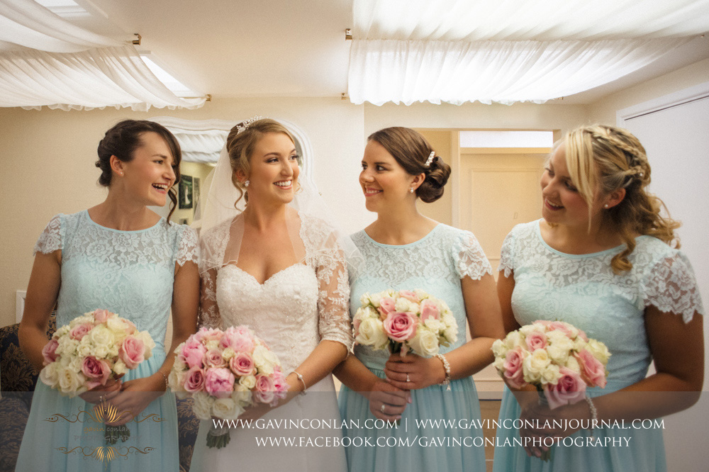 creative portrait of the bride and her bridesmaids. Wedding photography at  Parklands Quendon Hall  by preferred supplier  gavin conlan photography Ltd