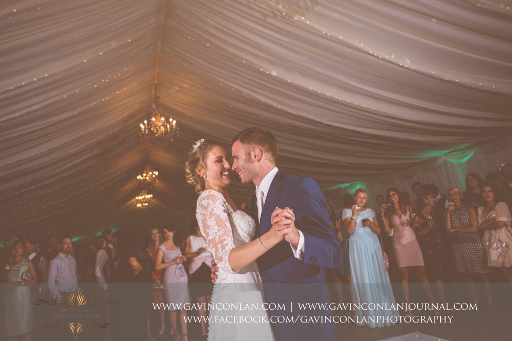 creative portrait of the bride and groom smiling at each other during their first dance song - All of Me by John Legend. Wedding photography at  Parklands Quendon Hall  by preferred supplier  gavin conlan photography Ltd