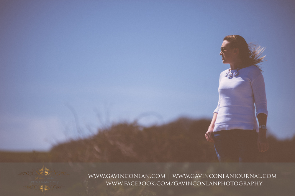 portrait of Victoria at  Old Harry Rocks . Victoria and James Engagement Session in Bournemouth, Dorset by gavin conlan photography Ltd