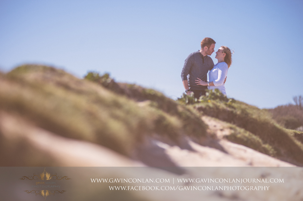 creative portrait ofVictoria and James looking at each other at  Old Harry Rocks .Engagement Session in Bournemouth, Dorset by gavin conlan photography Ltd