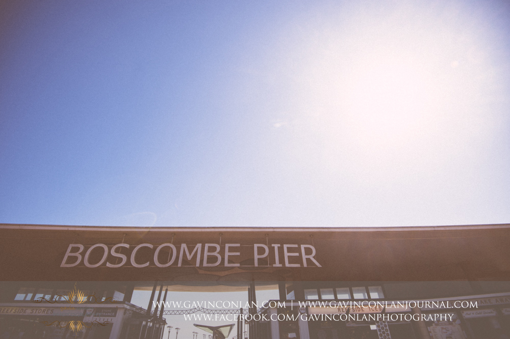 Boscombe Pier  sign.Victoria and James Engagement Session in Bournemouth, Dorset by gavin conlan photography Ltd