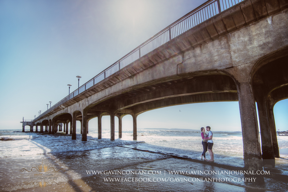 creative portrait of Victoria and James incorporating the whole of  Boscombe Pier .Engagement Session in Bournemouth, Dorset by gavin conlan photography Ltd
