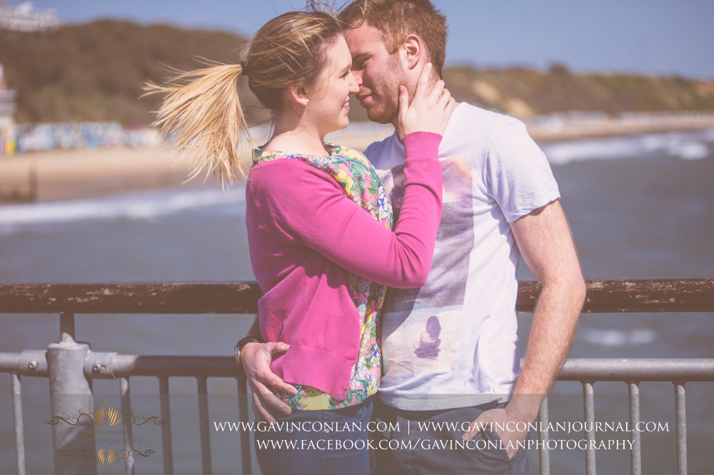 creative fashion portrait of Victoria and James on  Boscombe Pier .Engagement Session in Bournemouth, Dorset by gavin conlan photography Ltd