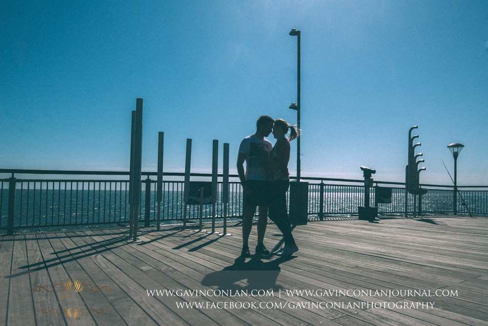 creative abstract portrait of Victoria and James on  Boscombe Pier .Engagement Session in Bournemouth, Dorset by gavin conlan photography Ltd