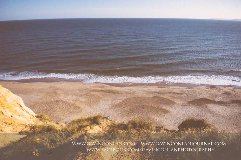 creative landscape looking down at the beach at Hengistbury Head .Victoria and James Engagement Session in Bournemouth, Dorset by gavin conlan photography Ltd