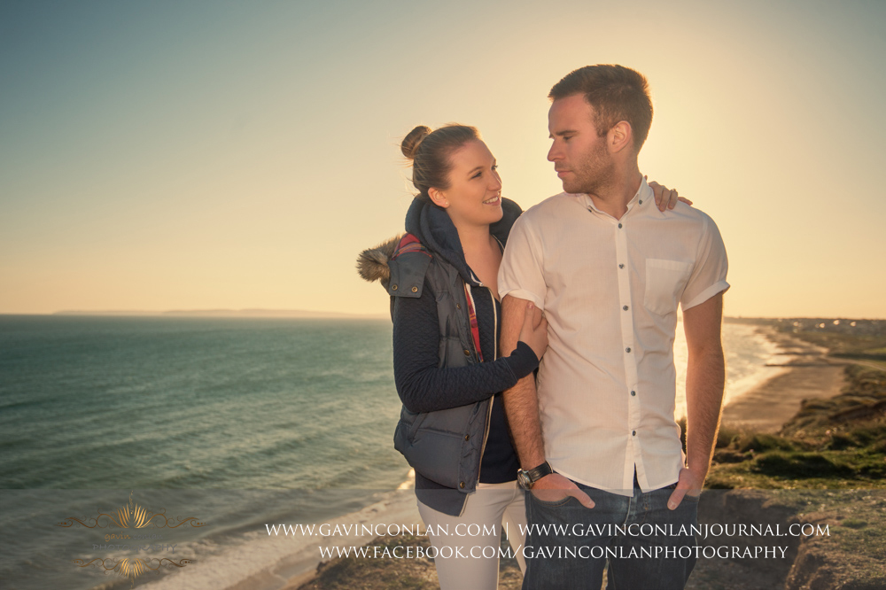 fashion portrait of Victoria and James at  Hengistbury Head  just before sunset. Engagement Session in Bournemouth, Dorset by  gavin conlan photography Ltd