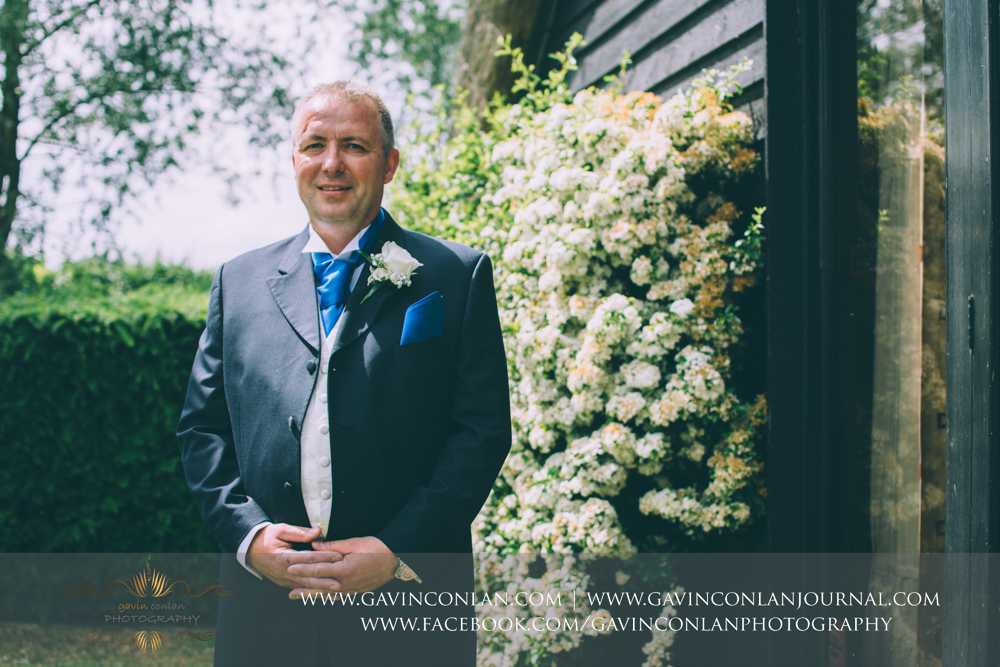 groom portrait posing outside of The Barn.Wedding photography at The Barn Brasserie by Essex wedding photographer gavin conlan photography Ltd
