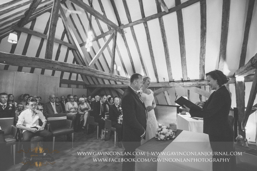 creative black and white wedding ceremony photograph.Wedding photography at The Barn Brasserie by Essex wedding photographer gavin conlan photography Ltd