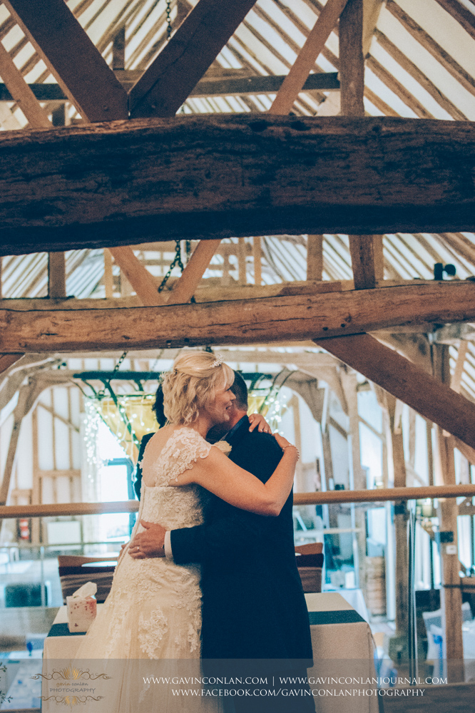 a portrait of the bride and groom sharing their firstembraceas Mr and Mrs.Wedding photography at The Barn Brasserie by Essex wedding photographer gavin conlan photography Ltd