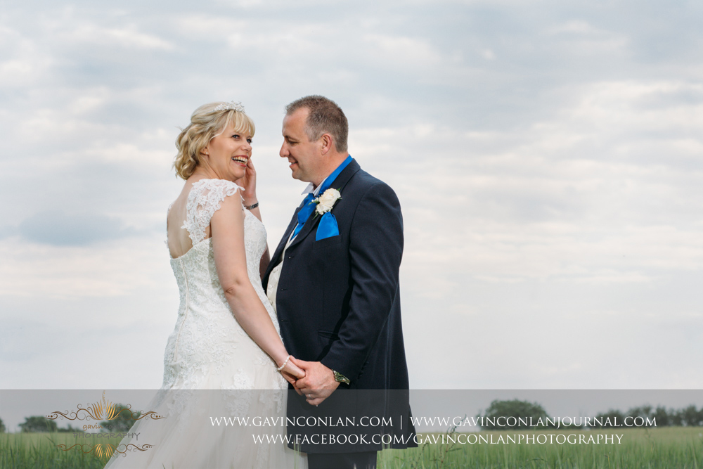 beautiful emotive portrait of the bride and groom together.Wedding photography at The Barn Brasserie by Essex wedding photographer gavin conlan photography Ltd