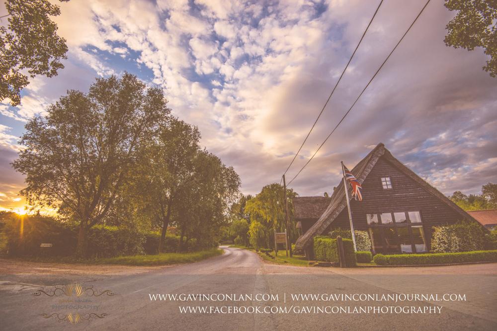 creative landscape photograph showcasing The Barn and the glorious sunset.Wedding photography at The Barn Brasserie by Essex wedding photographer gavin conlan photography Ltd