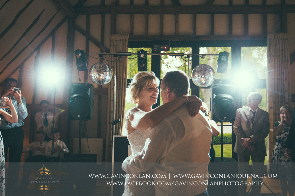 creative portrait of the bride and groom during their first dance.Wedding photography at The Barn Brasserie by Essex wedding photographer gavin conlan photography Ltd