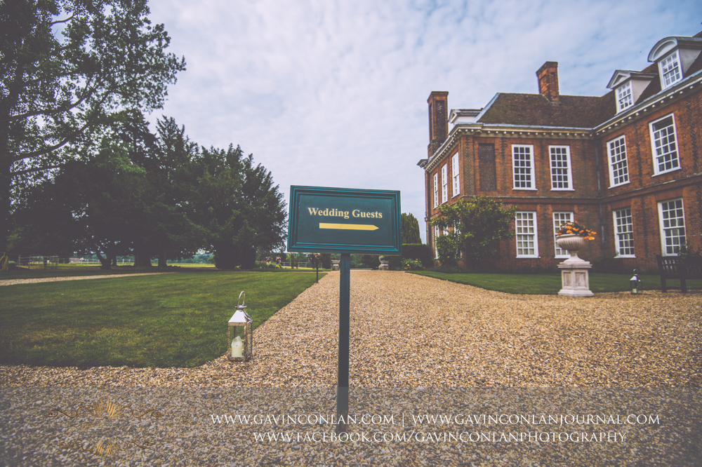 creative landscape of the exterior of Gosfield Hall showing the green Wedding Guests sign.Wedding photography at Gosfield Hall by Essex wedding photographer gavin conlan photography Ltd
