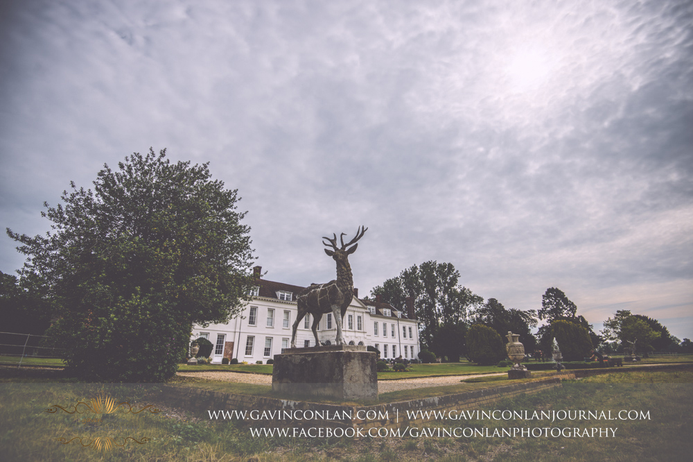 creative fine art landscape showcasing the exterior of Gosfield Hall with the Deer statue in the foreground.Wedding photography at Gosfield Hall by Essex wedding photographer gavin conlan photography Ltd
