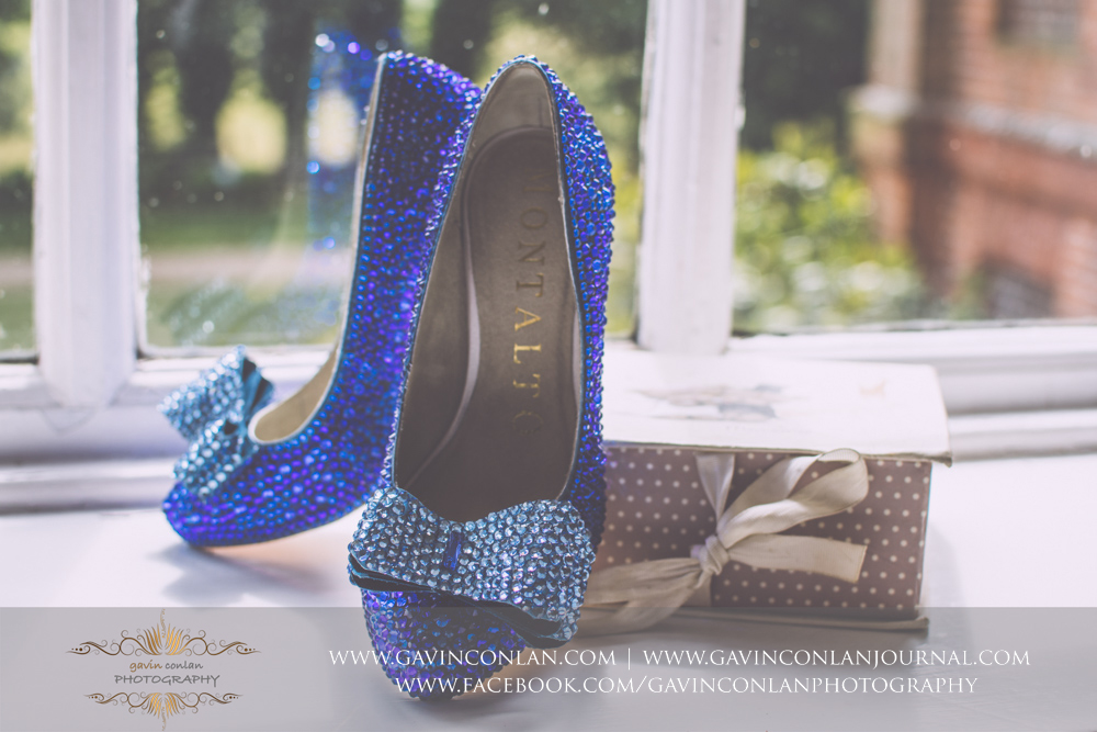 creative detail photograph of the gorgeous blue crystal bridal shoes.Wedding photography at Gosfield Hall by Essex wedding photographer gavin conlan photography Ltd