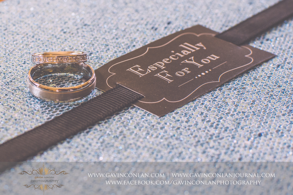 creative detail photograph of the bride and grooms wedding rings and text saying Especially for You in The Kings Apartment.Wedding photography at Gosfield Hall by Essex wedding photographer gavin conlan photography Ltd