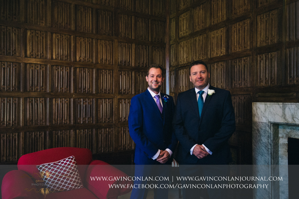 traditional formal portrait of the groom and best man in The Prophets Chamber.Wedding photography at Gosfield Hall by Essex wedding photographer gavin conlan photography Ltd