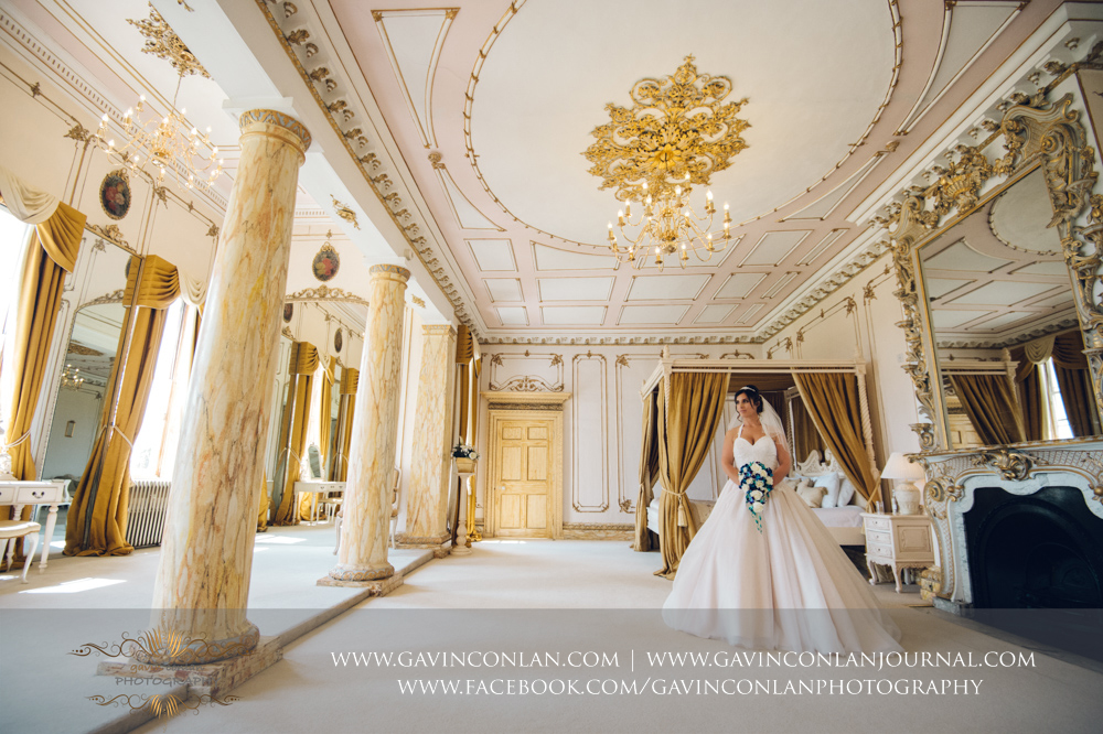simply stunning portrait of the bride holding her bouquet in The Rococco Suite.Wedding photography at Gosfield Hall by Essex wedding photographer gavin conlan photography Ltd