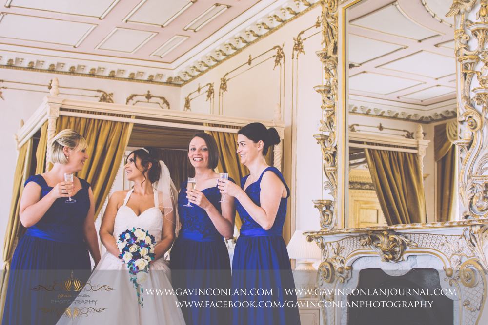 fun portrait of the bride and her bridesmaids in The Rococco Suite.Wedding photography at Gosfield Hall by Essex wedding photographer gavin conlan photography Ltd