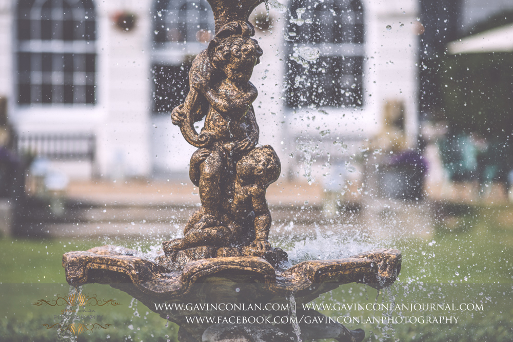 creative detail photograph of the water fountain in the grounds of Gosfield Hall.Wedding photography at Gosfield Hall by Essex wedding photographer gavin conlan photography Ltd