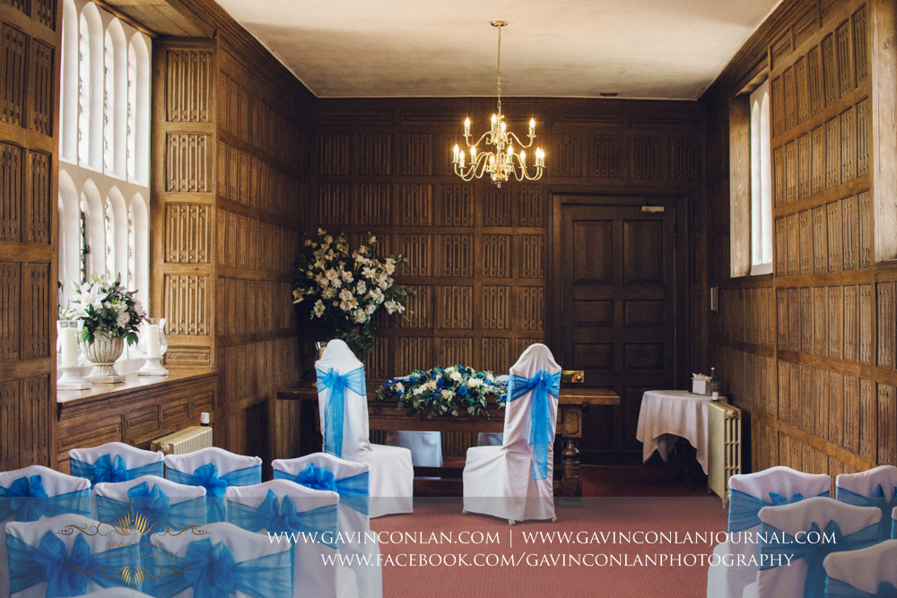 creative portrait of the ceremony room all set up for the wedding of Lisa and Rob in The Queens Gallery.Wedding photography at Gosfield Hall by Essex wedding photographer gavin conlan photography Ltd