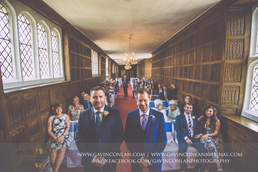 creative and fun selfie of the groom and his best man standing at the front of the aisle in The Queens Gallery.Wedding photography at Gosfield Hall by Essex wedding photographer gavin conlan photography Ltd