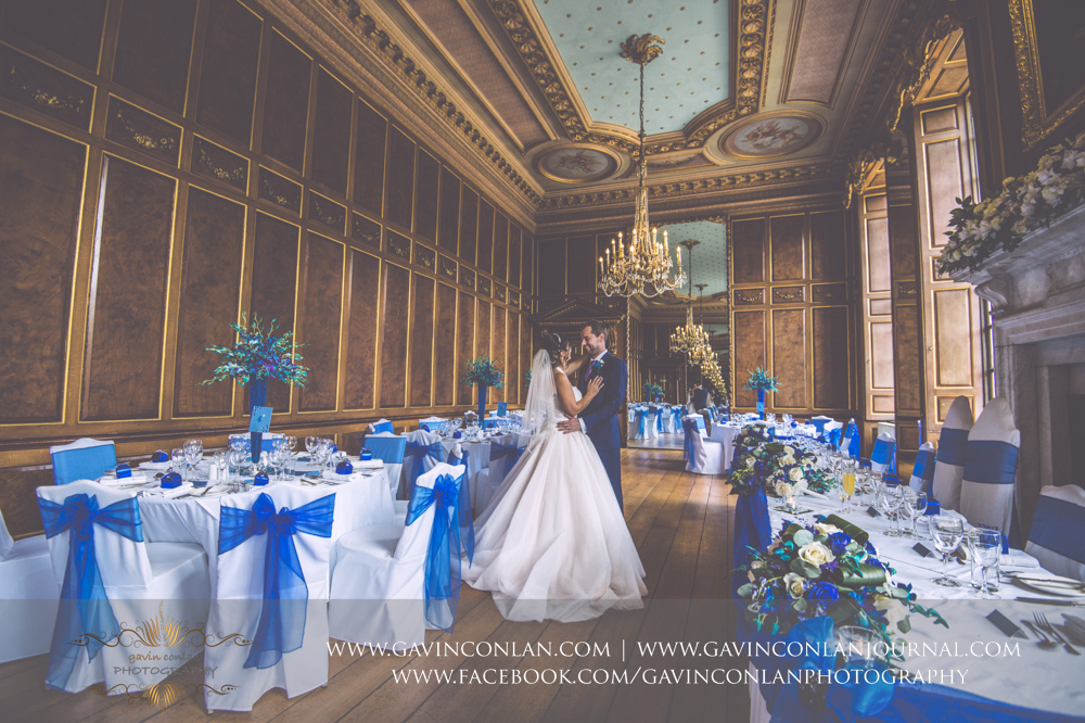 creative portrait of the bride and groom sharing a moment in the ballroom before the wedding breakfast.Wedding photography at Gosfield Hall by Essex wedding photographer gavin conlan photography Ltd