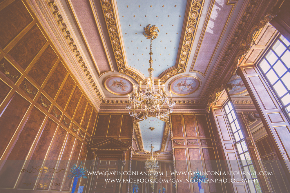 beautiful interior photograph of the ballroom showcasing the stunning chandeliers.Wedding photography at Gosfield Hall by Essex wedding photographer gavin conlan photography Ltd