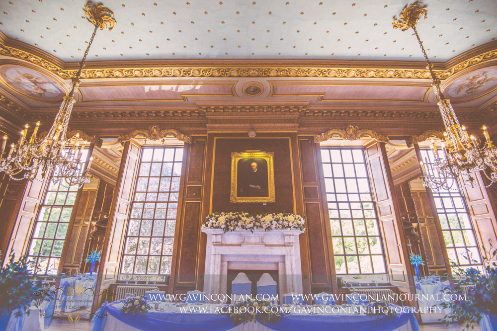 beautiful interior photograph of the ballroom showcasing the stunningchandeliers over the top table.Wedding photography at Gosfield Hall by Essex wedding photographer gavin conlan photography Ltd
