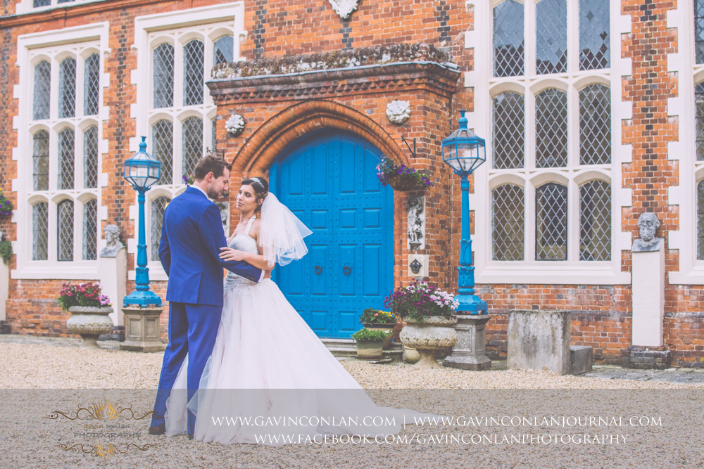 beautiful portrait of the bride and groom in the inner courtyard of Gosfield Hall.Wedding photography at Gosfield Hall by Essex wedding photographer gavin conlan photography Ltd