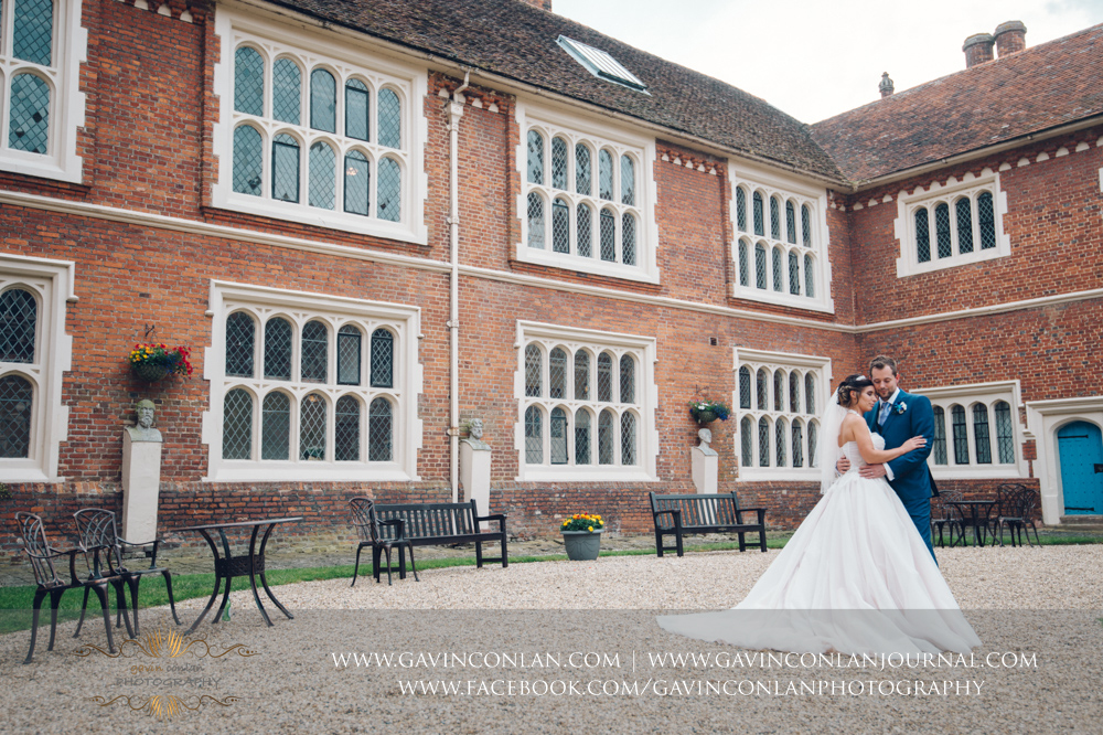 timeless portrait of the bride and groom in the inner courtyard of Gosfield Hall.Wedding photography at Gosfield Hall by Essex wedding photographer gavin conlan photography Ltd