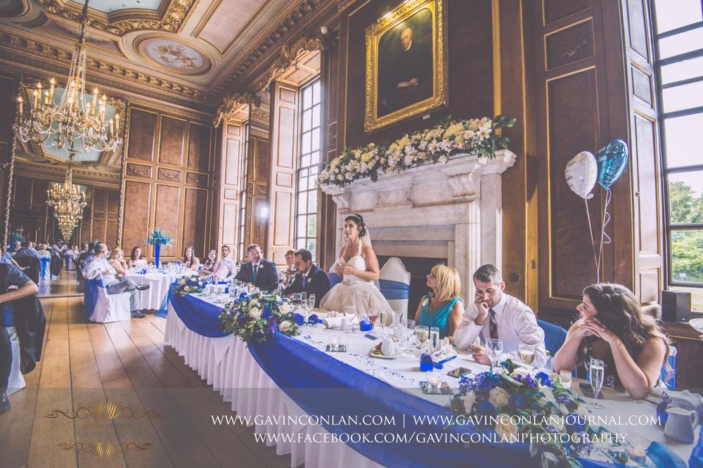 portrait of the bride during her wedding breakfast speech in the ballroom. Wedding photography at Gosfield Hall by Essex wedding photographer gavin conlan photography Ltd