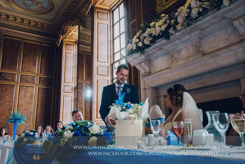 portrait of the groom during hiswedding breakfast speech in the ballroom.Wedding photography at Gosfield Hall by Essex wedding photographer gavin conlan photography Ltd