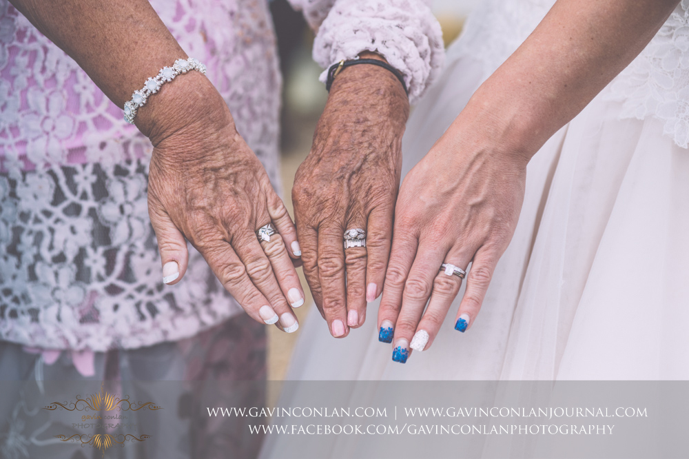 timeless and elegant legacy portrait of the showcasing the hands and wedding rings of the bride, her mother and her grandmother.Wedding photography at Gosfield Hall by Essex wedding photographer gavin conlan photography Ltd