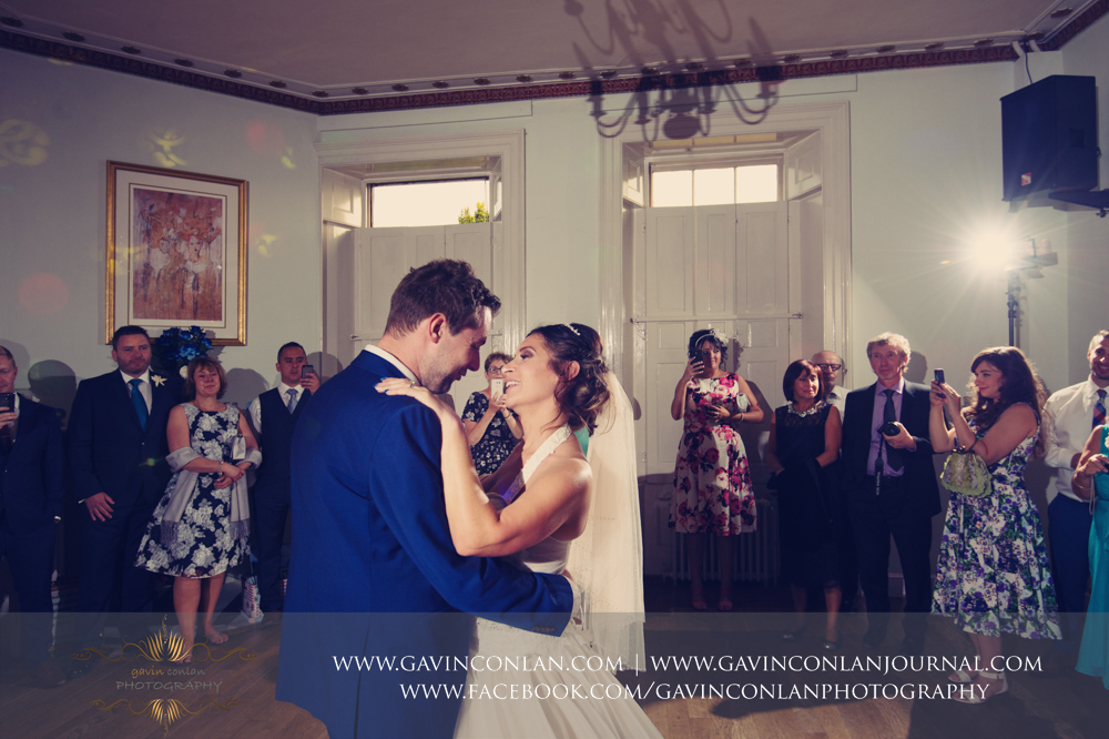 creative portrait of the bride and groom during their first dance.Wedding photography at Gosfield Hall by Essex wedding photographer gavin conlan photography Ltd