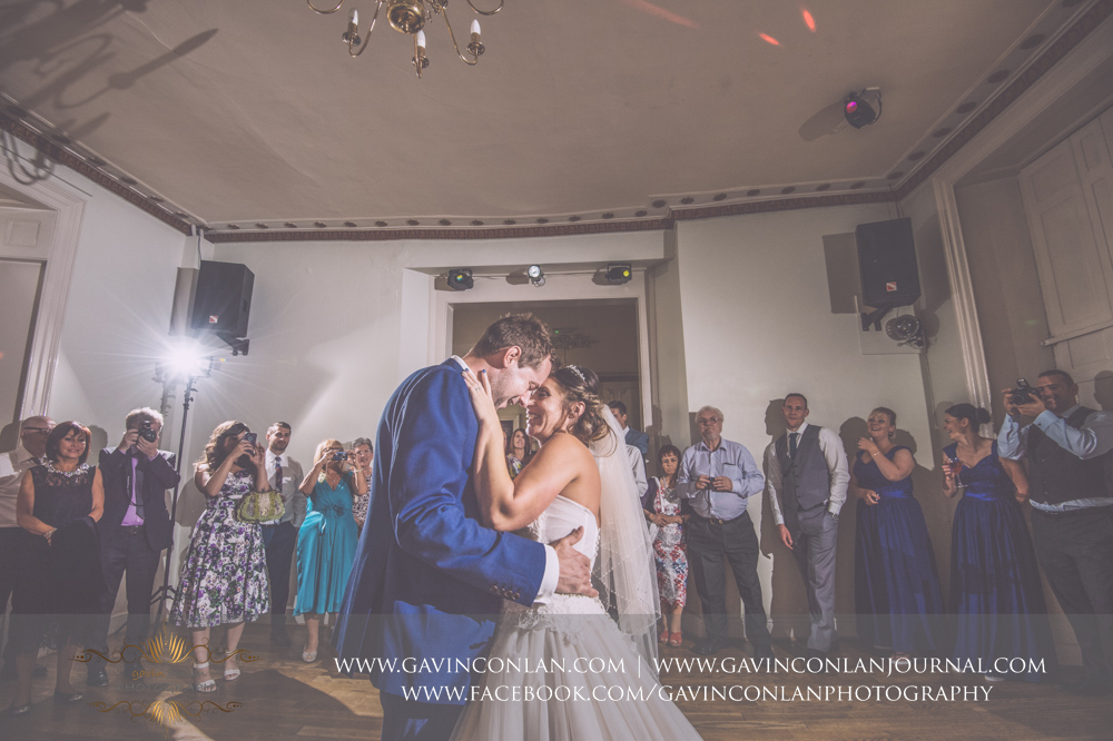 beautiful portrait of the bride and groom during their first dance with all their guests looking on with joy.Wedding photography at Gosfield Hall by Essex wedding photographer gavin conlan photography Ltd