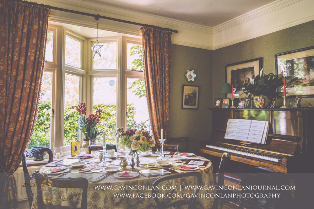 interior of the breakfast room at Alconbury Guest House showcasing the piano. Wedding photography at  Alconbury Guest House  by  gavin conlan photography Ltd
