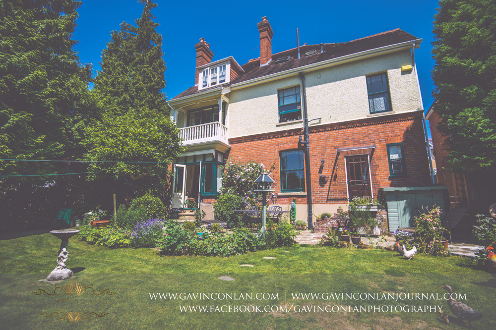 exterior of the beautiful garden of Alconbury Guest House showcasing the stunning balcony. Wedding photography at  Alconbury Guest House  by  gavin conlan photography Ltd