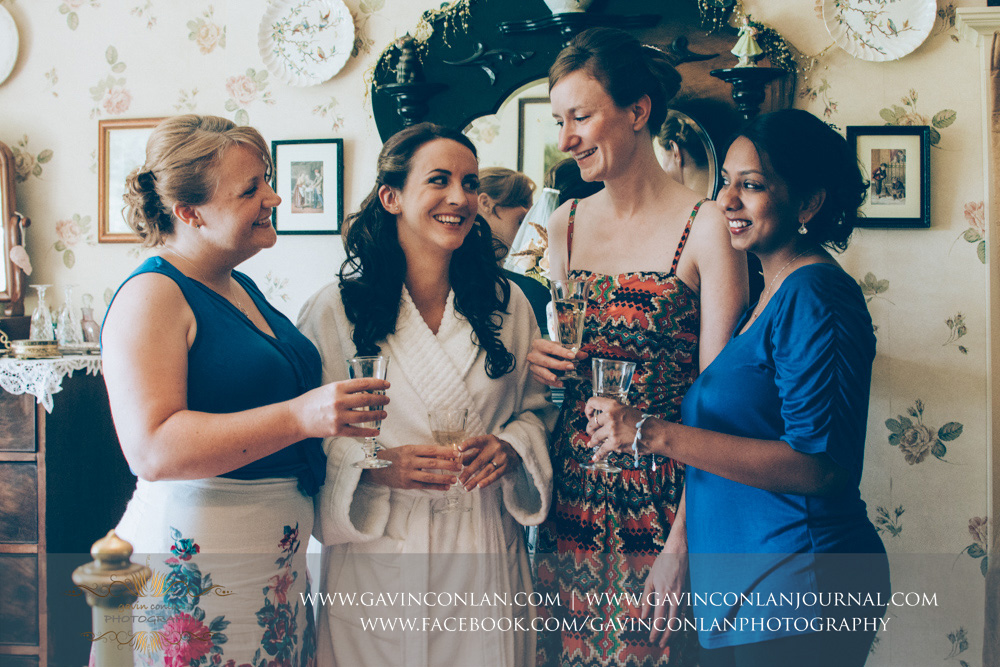 creative portrait of the bride and her bridesmaids before they get dressed in the luxurious Balcony Suite. Wedding photography at  Alconbury Guest House  by  gavin conlan photography Ltd