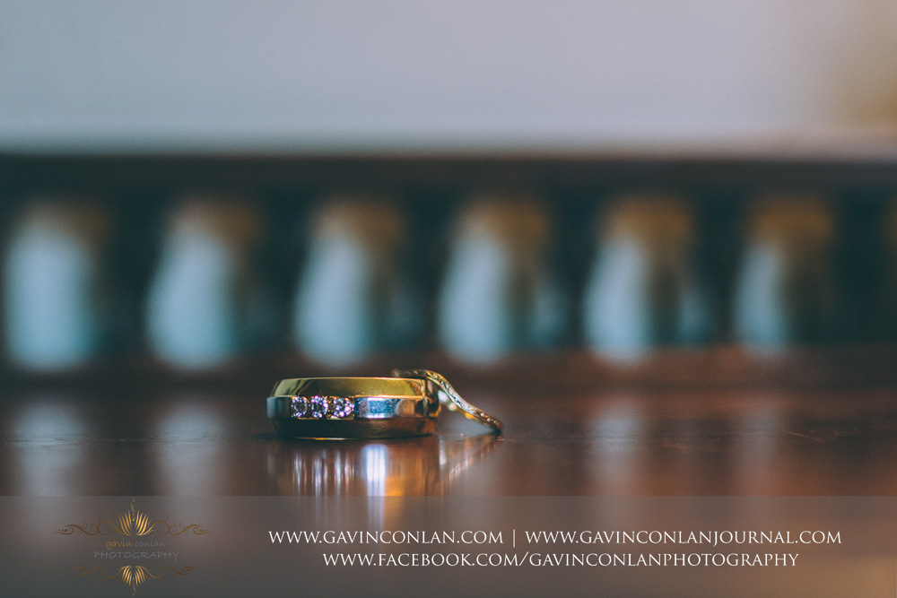 creative detail photograph of the wedding rings. Wedding photography at  Alconbury Guest House  by  gavin conlan photography Ltd